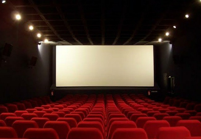 Filmmakers debating about Theatres